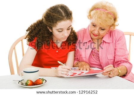 Senior woman helping her eighteen year old granddaughter register to vote for the first time.  Isolated on white. - stock photo