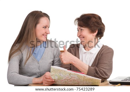 senior woman her daughter reading map and choosing  vacation