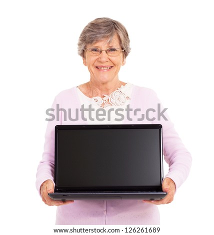 senior woman holding a laptop computer isolated on white