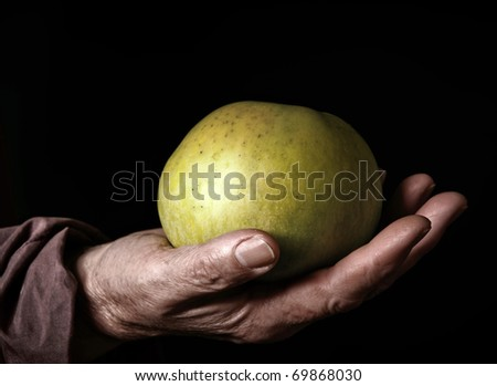 Senior Woman Holding Apple in her Palm.