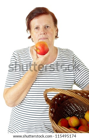 senior woman holding fresh apple