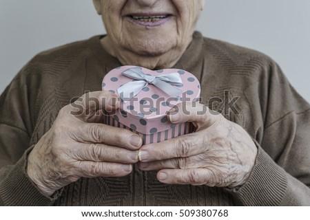 senior woman holding gift