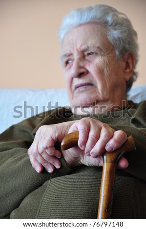 senior woman holding her cane