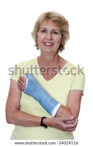 Senior woman holding left arm in cast