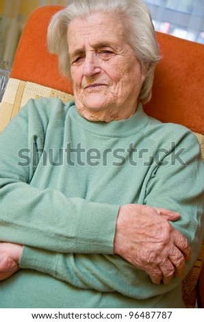 Senior woman holding painful arm