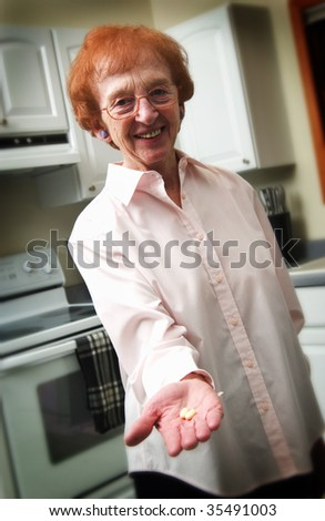senior woman holding pills