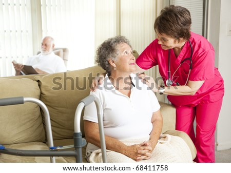 Senior woman in a nursing home with a caring nurse