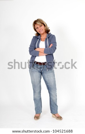 Senior woman in blue jeans standing on white background