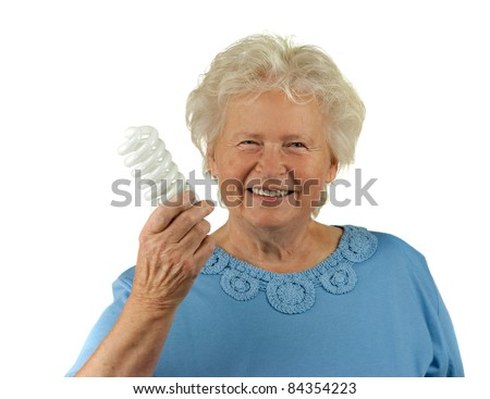 senior woman is holding a energy efficient light