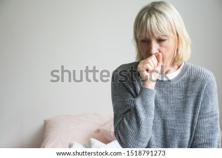Senior woman is sick, sore throat,cough isolated on white background.Sick woman with sore throat and having cough.