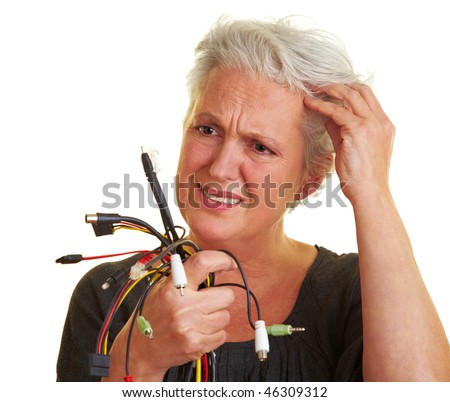 Senior woman looking at many different cables