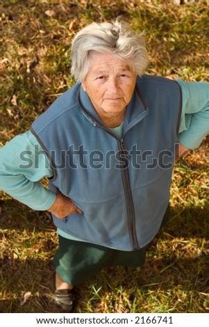 Senior woman looking up at the camera.