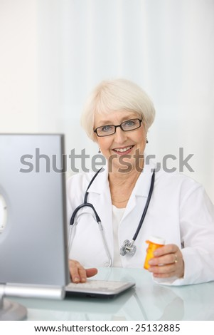 Senior woman medical worker with computer