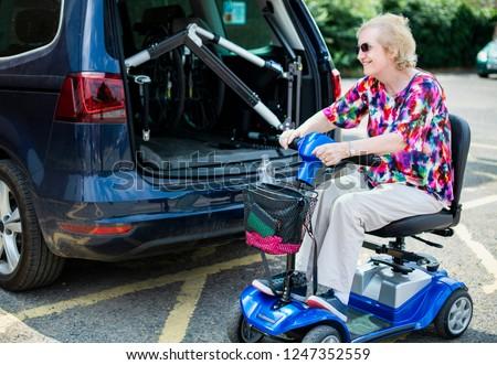 Senior woman on an electric wheelchair