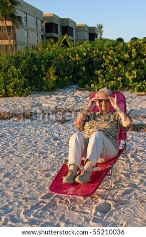Senior Woman On Beach Sunset Sanibel Florida