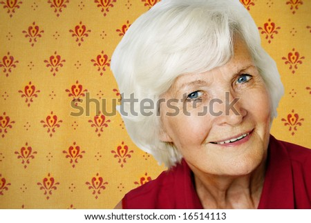 Senior woman portrait on a vintage wallpaper background