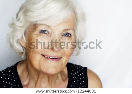 Senior woman portrait on grey with copy-space
