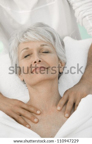 Senior woman receiving neck massage