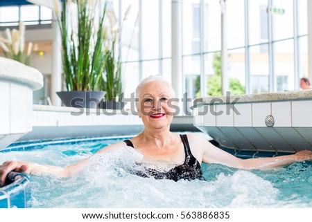 Senior woman relaxing in wellness spa