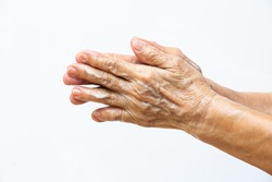Senior woman's hands washing her hands using soap foam in step 1 on white background, Close up & Macro shot, Selective focus, Prevention from covid19, Bacteria, healthcare concept, 7 step wash hand