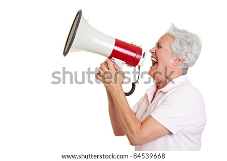 Senior woman screaming loudly in a megaphone