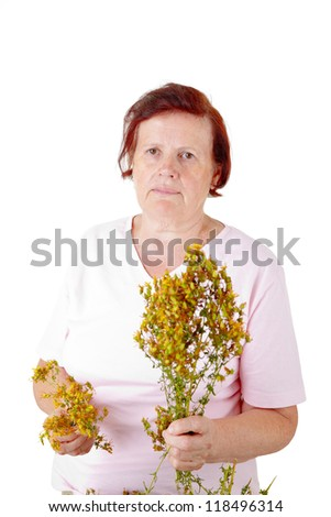 senior woman selecting hypericum