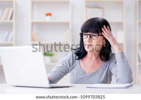 Senior woman struggling at computer
