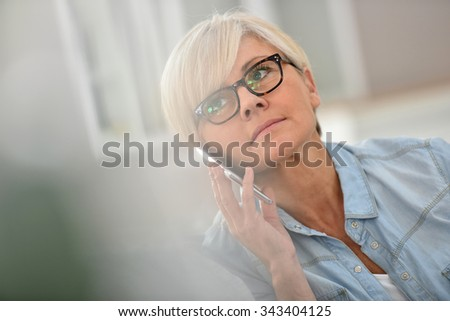 senior woman talking on mobile...