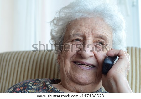 senior woman talking on phone indoor