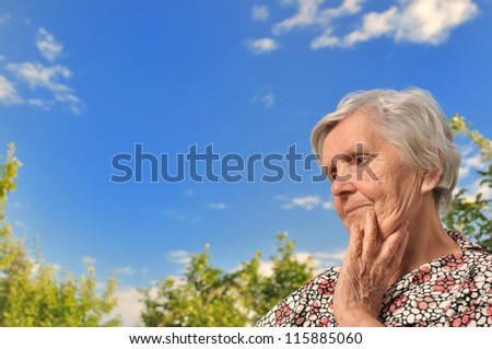 Senior woman - thinking, outdoors. MANY OTHER PHOTOS WITH THIS SENIOR WOMAN IN MY PORTFOLIO.