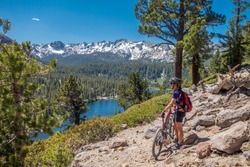 senior woman underway with her electrical mountainbike in the wilderness of Mammoth lakes,California,USA
