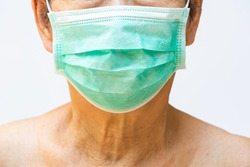 Senior woman wearing face mask, Medical mask, Surgical mask in white background, Front view, Close up & Macro shot, Select focus, Prevention from covid19, Coronavirus, Bacteria, Healthcare concept