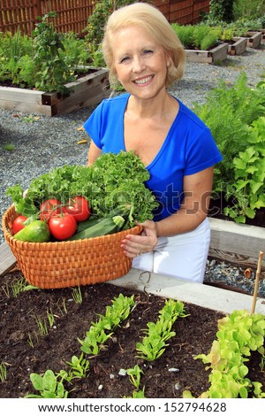 Senior woman with a basket of fresh vegetables.