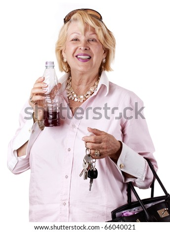 Senior Woman with bottle of juice and House/Car Key in her Hand (isolated on white)