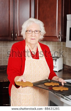 senior woman with gingerbread snowman
