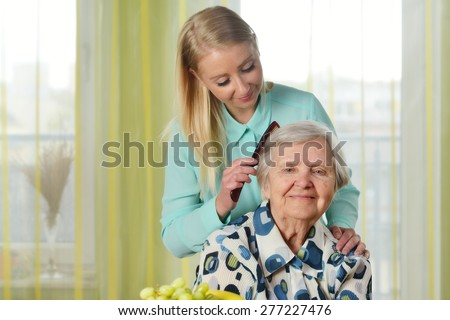 Senior woman with her caregiver in home. MANY OTHER PHOTOS FROM THIS SERIES IN MY PORTFOLIO.