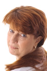 senior woman with red hair upclose