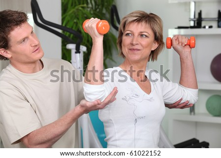 Senior woman with sports trainer
