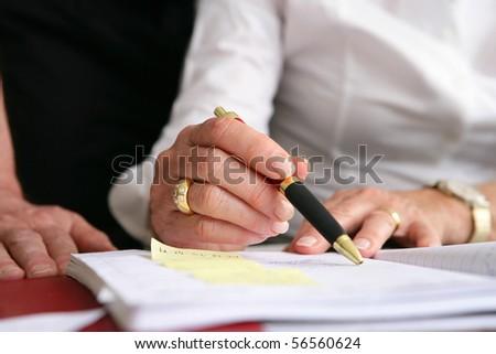 Senior woman writing on a diary