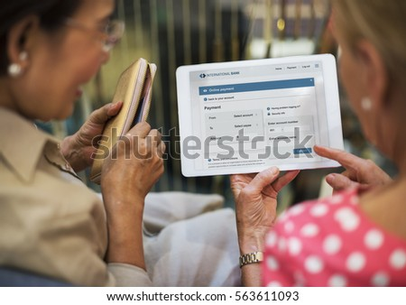 Senior Women Use Tablet Online Payment #563611093