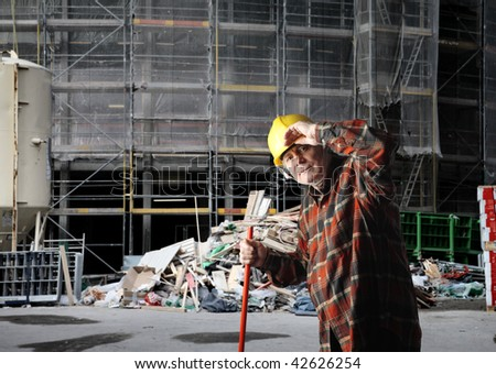 senior worker in construction yard - stock photo
