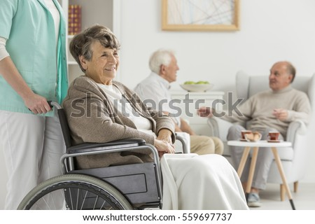Shutterstock Seniors at recreation room at nursing home