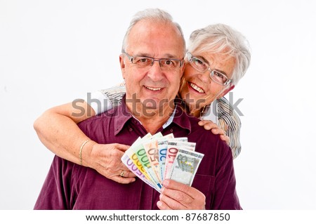 Seniors couple is happy about a lot of money