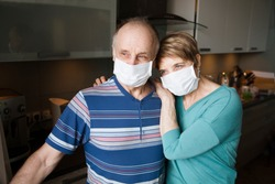 Seniors couple  wearing medical face mask and recovery from the illness in home. quarantine. health concept. Corona Virus.