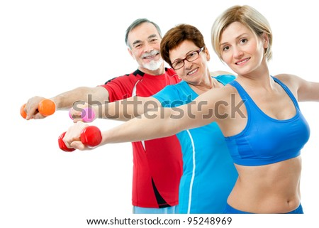 Seniors doing fitness exercises with help of trainer at sport gym