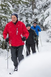 Seniors enjoy themselves cross country skiing in the winter on skis