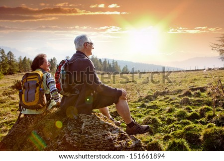 seniors hiking in nature on an autumn day