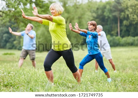 Seniors in the wellness class do Qi Gong or Tai Chi exercise for relaxation Сток-фото ©