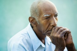 Seniors portrait of contemplative old african american man looking away. Copy space
