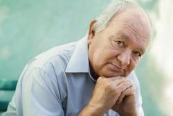 Seniors portrait of contemplative old caucasian man looking at camera. Copy space